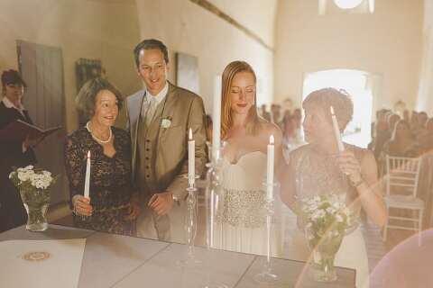 Lighting candles wedding ceremony